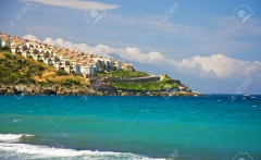 5125342-Beach-view-of-hill-with-many-houses-Kusadasi-Turkey-Stock-Photo