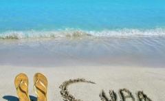 Gold sandals on a beach