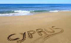 Cyprus written on sandy beach