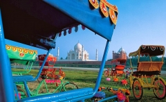 Rickshaws and view of Taj Mahal, Agra, India