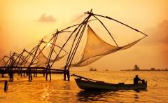 Sunset-over-Chinese-Fishing-nets-and-boat-in-Cochin-Kochi-Kerala-India-shutterstock_104171129
