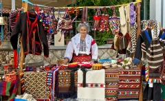 lady-in-traditional-clothes-selling-on-booth-dalibor-brlek